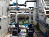 Jet mixer piping configuration